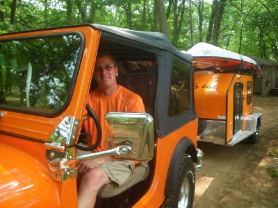 Orange color jeep and trailer and Legend sea kayak, nigel foster image