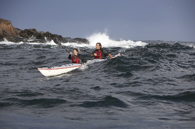 Surfing swells in DoubleShot tandem kayak by Nigel Foster