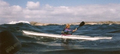 Catching a wave, Silhouette in Sweden, Nigel Foster with seaward Kayaks